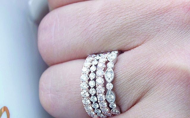 Jewelers agree that stacking bands is a popular trend. Add more later as anniversaries accrue.