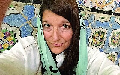 Carrie Rosefsky Wickham wears a headscarf, when appropriate, in Muslim countries.