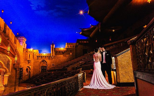 Vicki and Ryan Holzer wedding photo on August 22, 2015 at The Fox Theatre.  Photo by Vue Photography