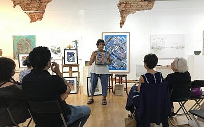 """Photo courtesy of Donna Kreuger/dk Gallery // Flora Rosefsky speaks about her work, """"S'chach,"""" at dk Gallery in Marietta."""