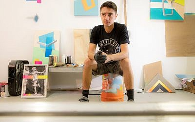 Artist Adam Podber is surrounded by works in progress at his studio at MET Atlanta on the West End.