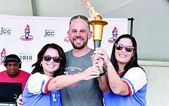 Carrying the torch of the Maccabi Games are Amy Rubin, Jared Powers and Libby Hertz.