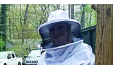 Michelle Harvey and her son, Max, dress in beekeeping suits in order to tend to their hive.