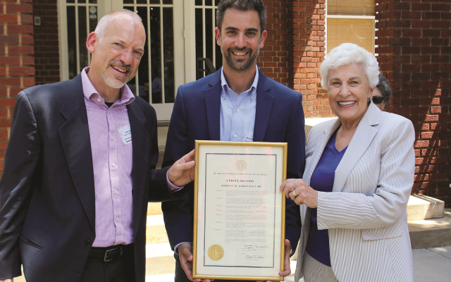Mayor-Elect Kelly Girtz, Hillel at UGA Director Roey Shoshan, and Mayor Nancy Denson hold a governor's proclamation marking the 20th anniversary.