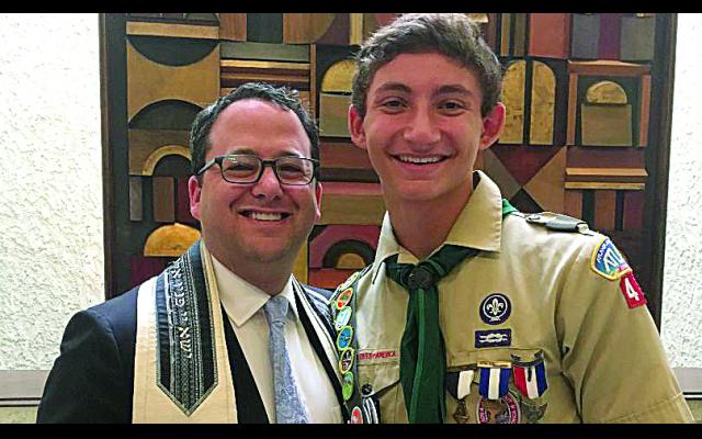 Rabbi Brad Levenberg presented the Etz Chaim  emblem to Ethan Hartz.