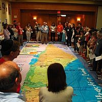 With Ken Stein's help, educators get a feel for Israel's geography at the 2011 summer workshop.