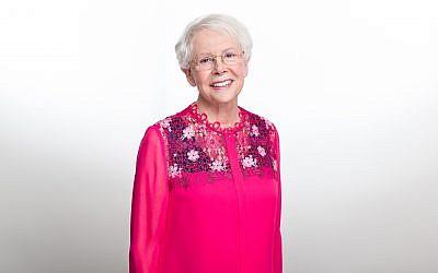 As a survivor herself, Billi wears pink for October Breast Cancer Awareness Month.