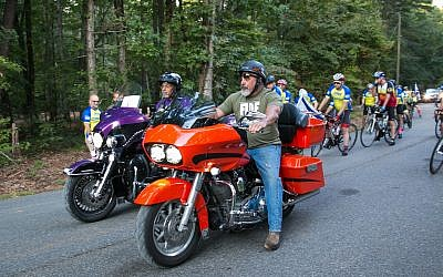 Some riders traveled on motorcycles.