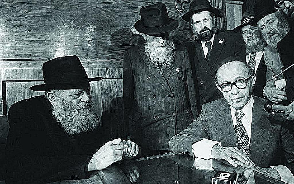 Photo by Yaacov Saar/GPO // Lubavitcher Rebbe, Rabbi Menachem Mendel Schneerson, seventh leader in the Chabad-Lubavitch dynasty, with Israeli Prime Minister Menachem Begin (right) in Brooklyn, N.Y.