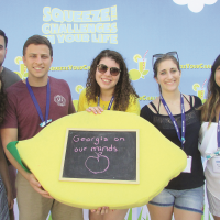 Georgia's SWU Emerson college fellows squeeze lemons representing their challenges. From front left: Shira Solomon, Josh Cohen, Talia Lerner, Melissa Harari and Mariana Ortiz, GSU Hispanic fellow, joined by SWU Hispanic outreach coordinator Sebastian Parra, back left.