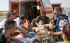 An IDF soldier receives blood.