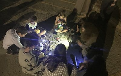 Kids and teens work on crafts and creating their own lanterns.