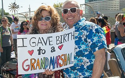 Rabbi Joshua Lesser, a parade grand marshal, poses with his supportive mom, Alayne Lesser.