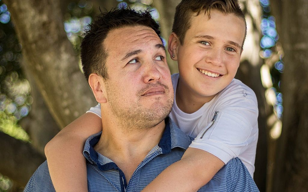 How frequent is the communication between father and son about physical body changes during puberty?