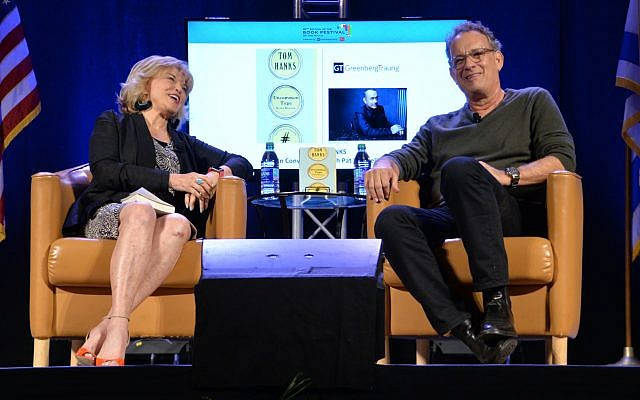 Tom Hanks, in conversation with Pat Mitchell, hammed it up for the audience.
