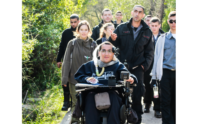 Israeli firefighters get a tour of a trail in LOTEM to understand how the parks have become more inclusive of people with disabilities.