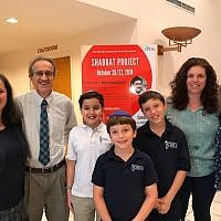 Lynn and Brian Gordon, Bobbi Livnat and Diane Bland, as well as children who delivered words of Torah at the Shabbat Project.