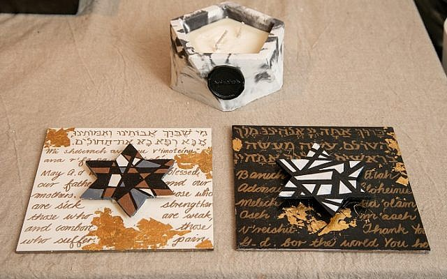 Karin's wood blessings are in Hebrew and English. Daughter Gina's handmade candle is atop.