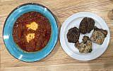 Traditional tomato-based shakshuka alongside tastes of lamb kebab and pargiot.