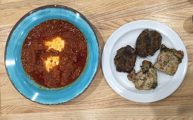 Traditional tomato-based shakshuka alongside tastes of lamb kebab and pargiot.