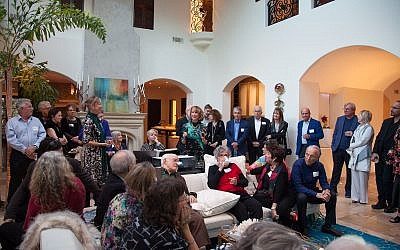 Photos by Laurie Sermos // Chai Style columnist, Marcia Caller Jaffe (center), welcomes party-goers.