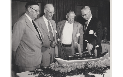 Sam Levy, right, joins other survivors at the 35th reunion of the Otranto sinking around a replica of the ship.