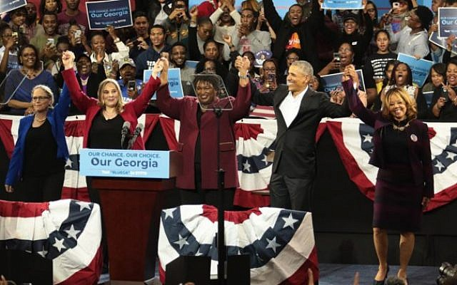 From left: Candidates Carolyn Bourdeaux, Sarah Riggs Amico, Stacey Abrams and Lucy McBath celebrate with former U.S. President Barack Obama at a campaign rally at Morehouse College's Forbes Arena.