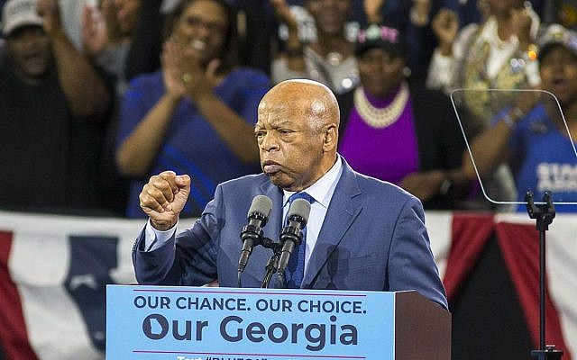 Congressman John Lewis, one of the last surviving members of Martin Luther King's inner circle, speaks at Abrams' rally.