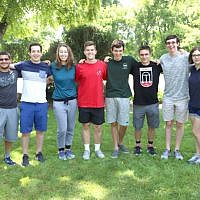 Nine undergraduates have been named Ramsey Honors Scholars. Eric Miller is the second student from the left and Marshall Berton is the third student from the right.