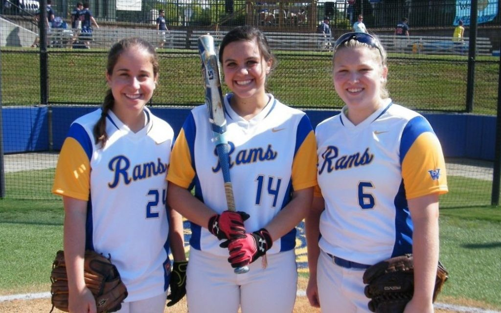 Weber softball senior Remy Zimmerman stands in betweensenior MeredithGalanti (left) and Sophomore Mauri Viness (right)