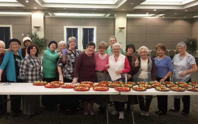 Women working with Congregation Beth Jacob's Kiddush committee put together trays of food for the block-party Shabbat celebration held Oct. 24.