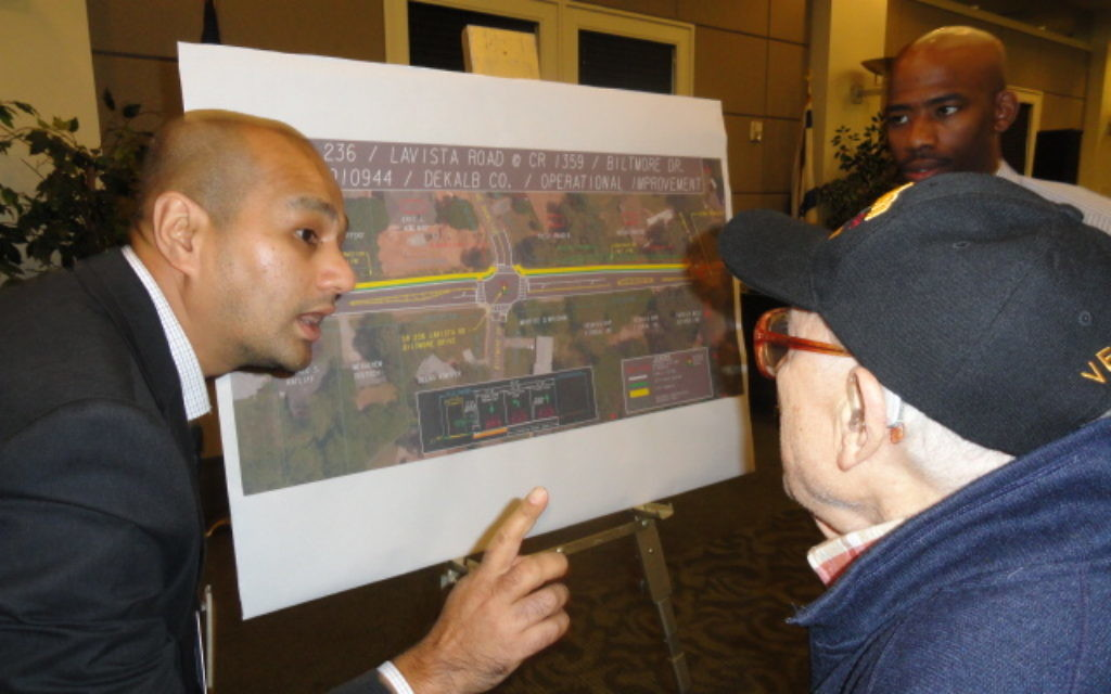 A Georgia Department of Transportation representative tries to address concerns about the road project.