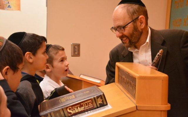 Torah Day School pupils study with sofer Rabbi Ariel Asa.