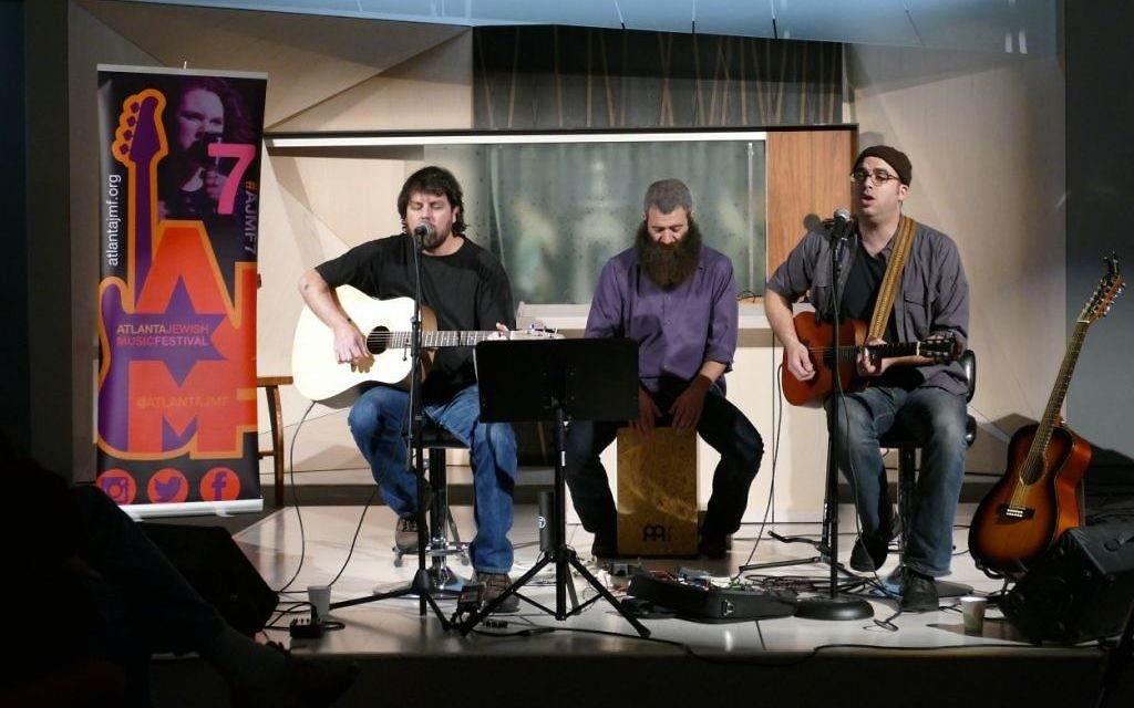 "Khen Rotem (left) and Ami Yares (right) perform songs from their album, named for the Grateful Dead's 1976 song ""Promised Land."" Drew Cohen joins in on the cajon."