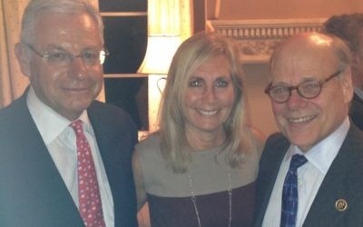 Alan and Lisa Lubel welcome Congressman Steve Cohen (right) to Sandy Springs.