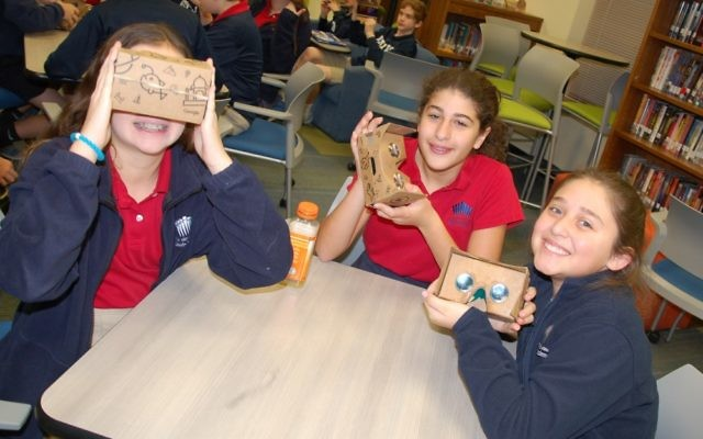 Davis Academy middle-schoolers test out the Google Cardboard viewer.