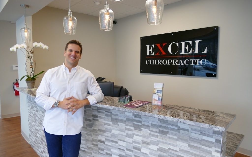 Above: Ben Cohen says he is excited to start helping Sandy Springs residents at his new practice, Excel Chiropractic.
