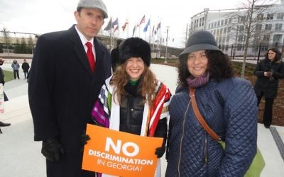 Rabbis David Spinrad, Malka Packer (center) and Ruth Abusch-Madger rally against the religious liberty bills Feb. 9.
