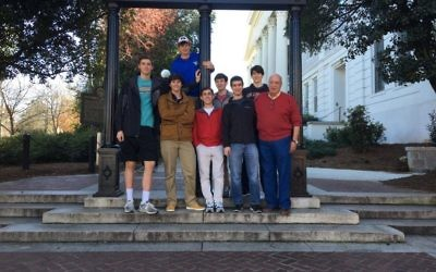 Model U.N. team members Aaron Gordon, Justin Wolozin, Yarden Willis, Asher Stadler, Adam Spector, Jordan Arbiv and Sam Fialkow hang out at UGA with faculty adviser Marc Leventhal. Not pictured is team member Shannan Berzack.