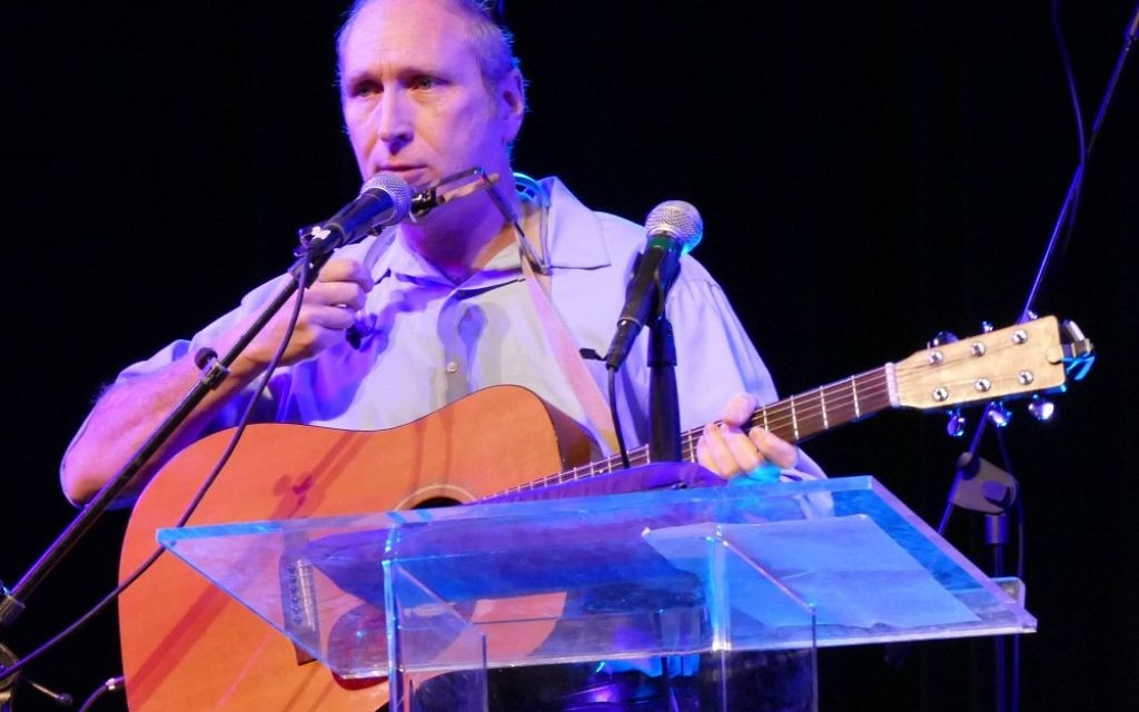 Rabbi Karmi Ingber, shown at KehillaFest, is a musician as well as an author.