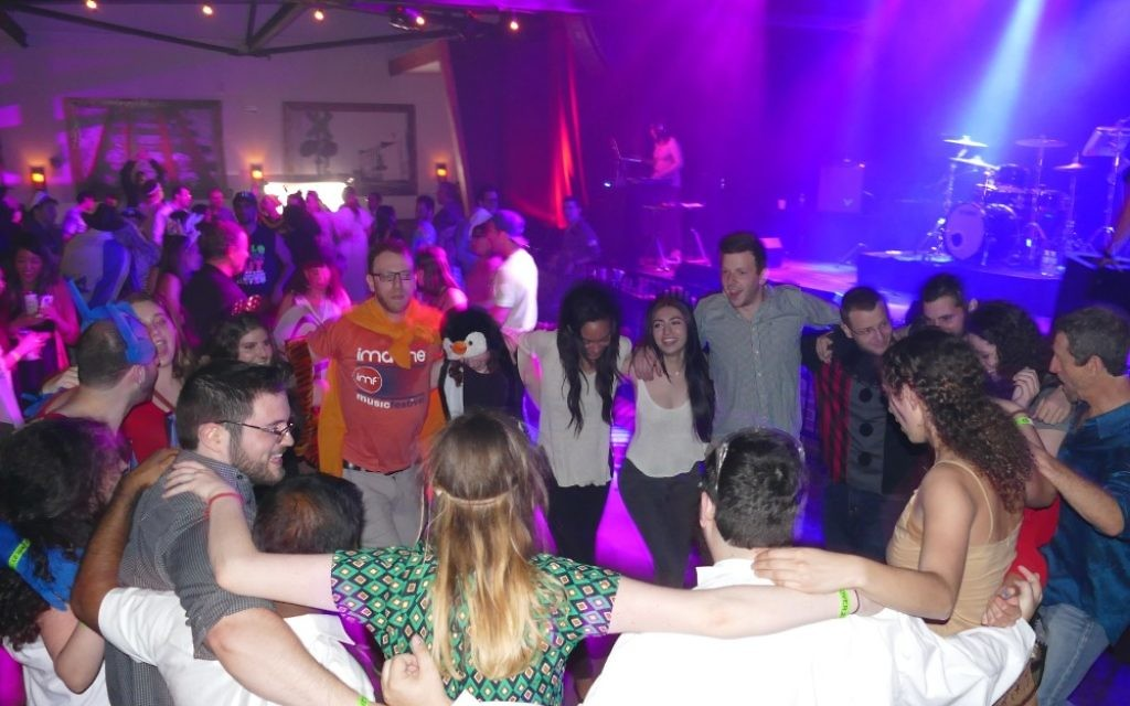The Purim party masquerading as the main event of AJMF7doesn't stop just because the bands are done at Terminal West. Adult revelers of all ages, many from Emory University, dance the hora to the house music even after co-headliners A-WA and Jaffa Road have left the building.