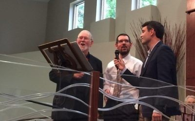 Dan Appelrouth sings with sons David and Jed at his annual hunger concert in 2015.