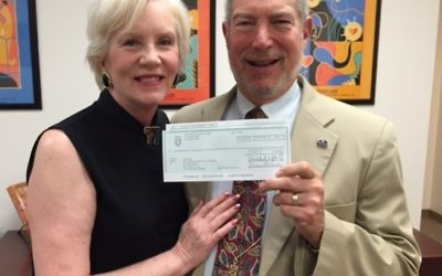 Bill Loventhal presents Hadassah Greater Atlanta President Paula Zucker a $5,000 check from the Million Dollar Round Table Foundation.