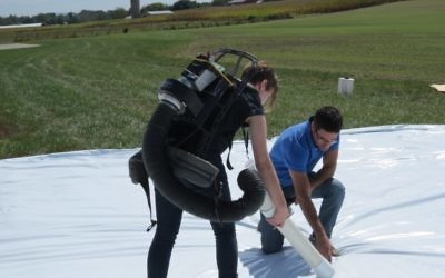 Senecio CEO Hanan Lepek helps a researcher collect the mosquitoes after the aerial test in September.