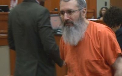 At his trial, Hemy Neuman wore a long beard and yarmulke.
