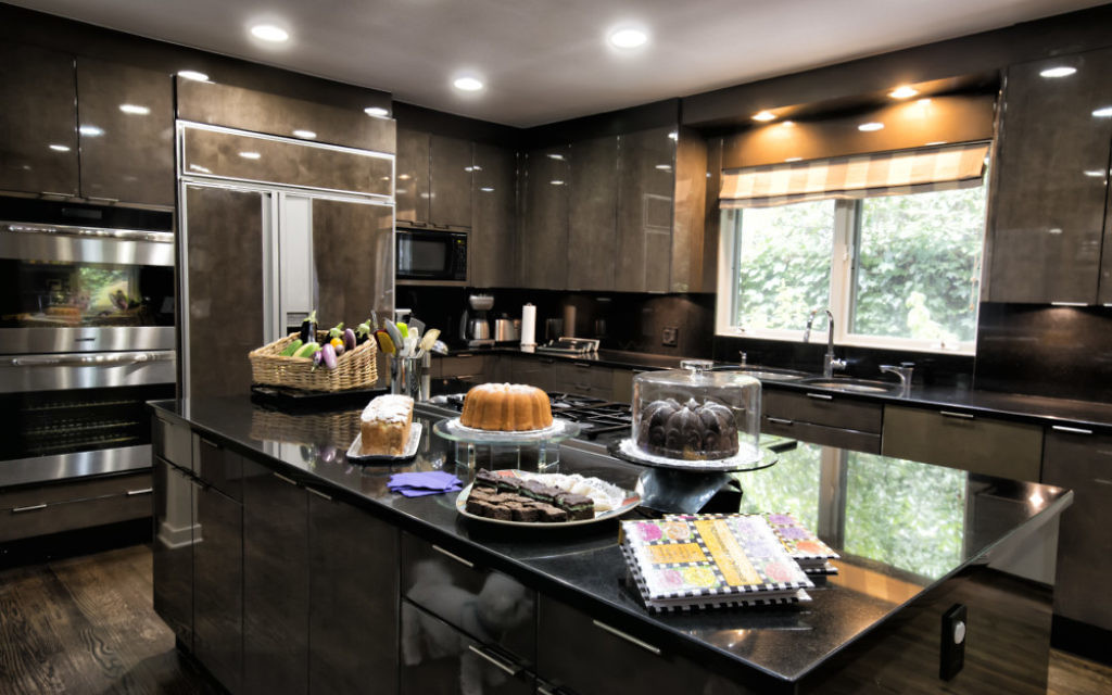 The Galleria Design kitchen provides a backdrop to Marianne Garber's baked goods, based on the cookbook she created of her mother's recipes, and fresh vegetables from Stephen Garber's garden. (Photo by Duane Stork)
