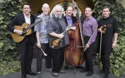 The David Grisman Sextet with David Grisman (mandolin) center. The remaining members of the group are Jim Kerwin (bass), Matt Eakle (flute), George Marsh (percussion), Chad Manning (fiddle) and George Cole (guitar).