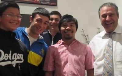 Antony Gordon and his sons hang out with client Manny Pacquiao.