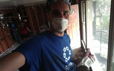 Rabbi Natan Trief works with Nechama to clean up flood damage in Baton Rouge.