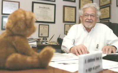 "Dentist Theodore ""Dr. Teddy Bear"" Levitas keepsastuffed friend nearby."